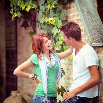 Couple-flirting-outside-by-brick-wall.jpg