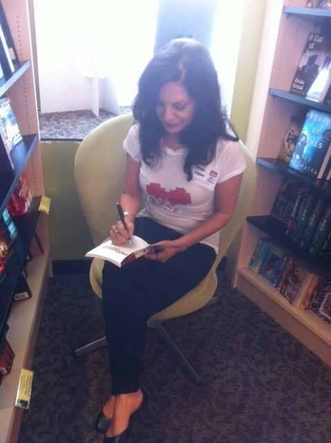 Book-signing-seated-Myst.-Galaxy-2.jpg