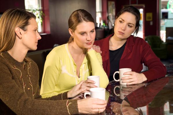 Woman-talking-to-friends.jpg